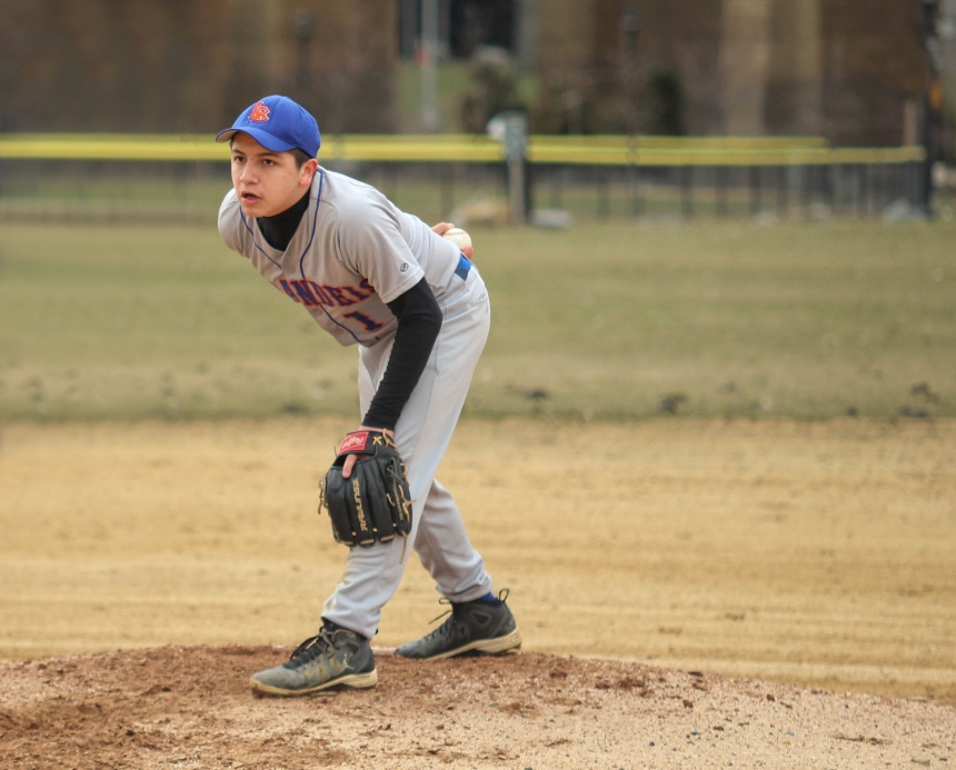 Photo: Corey Velazquez Senior Aaron Santos gears up to pitch during a game against Life Sciences Secondary High School.